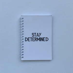"""Stay Determined"" A6 Notebook"